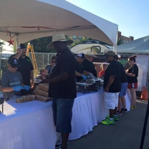Fri. night dinner buffet style catered by the wonderful alumni MeatMeisters BBQ team! Photo credit: Camp Craig Allen