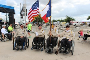Presenting the colors at the opening ceremony, the only color guard on wheels in America! Thank you to the Lone Star Chapter Paralyzed Veterans of America! Photo credit: Martin Camacho