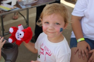 This little girl got her face painted, and a prize! Photo credit: Martin Camacho