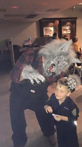 That little boy does not like scared of the werewolf! Just look at his eyes as he looks like he could turn on him!
